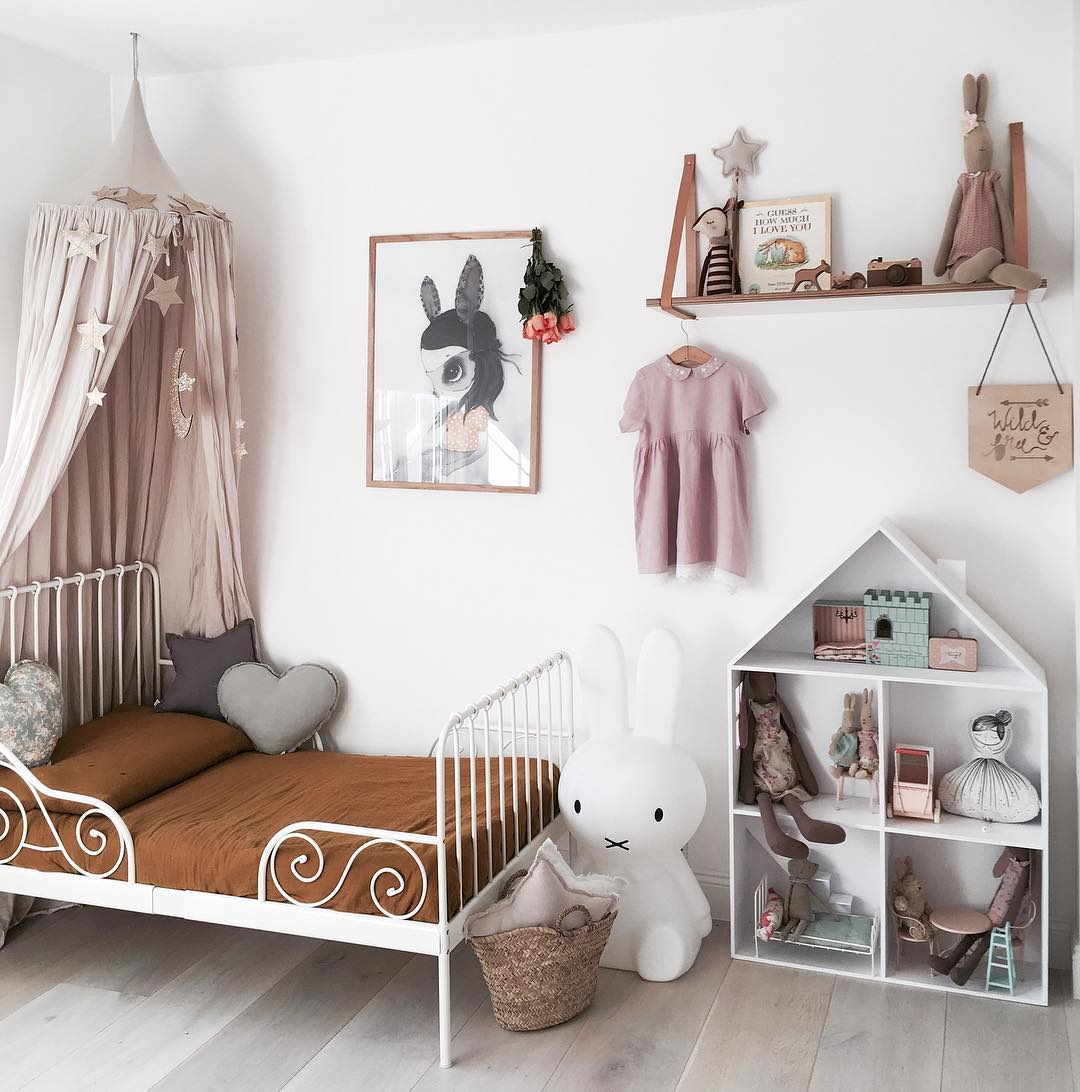Kids bedroom trends for 2018 include vintage glamour as seen with the vintage bed in this bedroom